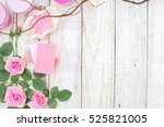 Stock photo pink roses vintage on white wooden background flat lay style 525821005