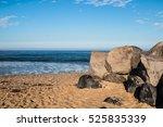boulders on sandy beach in... | Shutterstock . vector #525835339