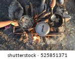 cooking dinner on firewood... | Shutterstock . vector #525851371