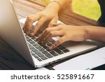 woman's hand typing on laptop... | Shutterstock . vector #525891667