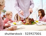 carving roasted turkey  | Shutterstock . vector #525927001