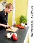 a woman cutting vegetables at... | Shutterstock . vector #5259385
