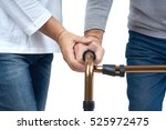 hands of nurse to senior... | Shutterstock . vector #525972475