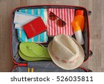 open suitcase packed for... | Shutterstock . vector #526035811
