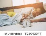 women moody and hit old alarm...   Shutterstock . vector #526043047