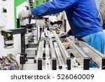 worker using filler machine to... | Shutterstock . vector #526060009
