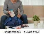 cropped image of man putting... | Shutterstock . vector #526065961