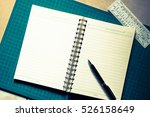 notepad and pen | Shutterstock . vector #526158649