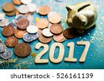 piggy bank and pound gbp coins | Shutterstock . vector #526161139