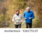 beautiful senior couple running ... | Shutterstock . vector #526175119
