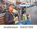 tourist in amsterdam eating... | Shutterstock . vector #526217305