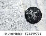hockey puck lies on snow...   Shutterstock . vector #526249711