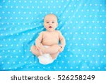 Cute Baby Lying On Color...