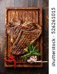 grilled t bone steak on serving ... | Shutterstock . vector #526261015