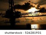 crane offshore sun set. | Shutterstock . vector #526281931