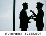 Silhouettes Of Two Businessmen...