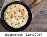 stack of pancakes on a cast...   Shutterstock . vector #526437064