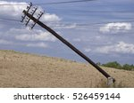 Leaning Old Wooden Electric Pole