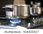 pot stands on a stove | Shutterstock . vector #526523317