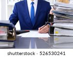 Small photo of Bookkeeper or financial inspector and secretary making report, calculating or checking balance. Internal Revenue Service inspector checking financial document. Audit concept.
