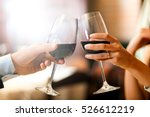 Couple Toasting Wineglasses In...