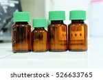 brown reagent bottle in