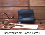 Small photo of Judge hammer on a dais