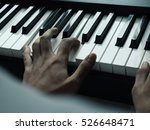 A Hand On Piano.