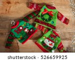 ugly winter sweater laid on a... | Shutterstock . vector #526659925