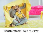 mother with child playing at... | Shutterstock . vector #526710199
