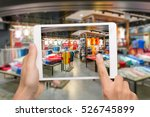 Small photo of Augmented reality marketing concept. Hand holding digital tablet smart phone use AR application to check special sale price in retail fashion shop mall