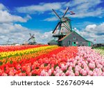 two traditional dutch windmills ... | Shutterstock . vector #526760944