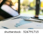 financial charts on the table... | Shutterstock . vector #526791715