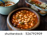 Small photo of Turkish Kuru Fasulye / Baked Beans in a wooden bowl.