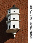 White Dovecote On Red Brick Wall