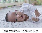 A Baby Boy Wearing A White...