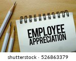 Small photo of Employee Appreciation text written on a notebook with pencils