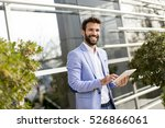 young businessman holding... | Shutterstock . vector #526866061