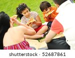 Happy people outdoor, family eating pizza - stock photo