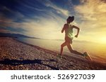 Stock photo healthy lifestyle young woman runner running on sunrise seaside 526927039