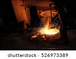Small photo of Foundry worker melting metal for casting spare parts