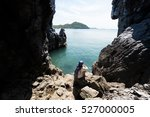 lady sitting in the cave sea... | Shutterstock . vector #527000005