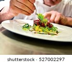 the chef prepares a meal. slim... | Shutterstock . vector #527002297