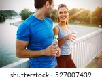 athletic couple jogging... | Shutterstock . vector #527007439