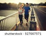 athletic couple jogging... | Shutterstock . vector #527007571