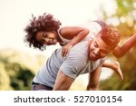father carrying daughter on... | Shutterstock . vector #527010154