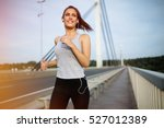 happy sporty woman jogging... | Shutterstock . vector #527012389