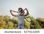 father carrying daughter on... | Shutterstock . vector #527013205