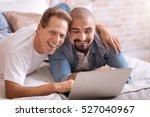 positive gay couple lying on...   Shutterstock . vector #527040967
