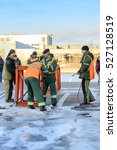 Small photo of MOSCOW, RUSSIA - NOVEMBER 11, 2016: State Unitary Enterprise Mosvodostok performs recovery vessels on coastal winter parking. Dockers prepare the place for the installation vessel.